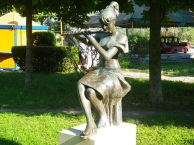 In Berat, a young girl plays the flute.